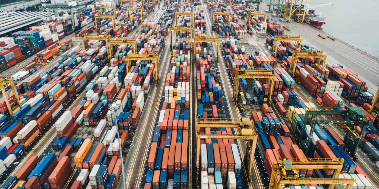 Aerial shot of thousands of shipping containers wharfside at a port