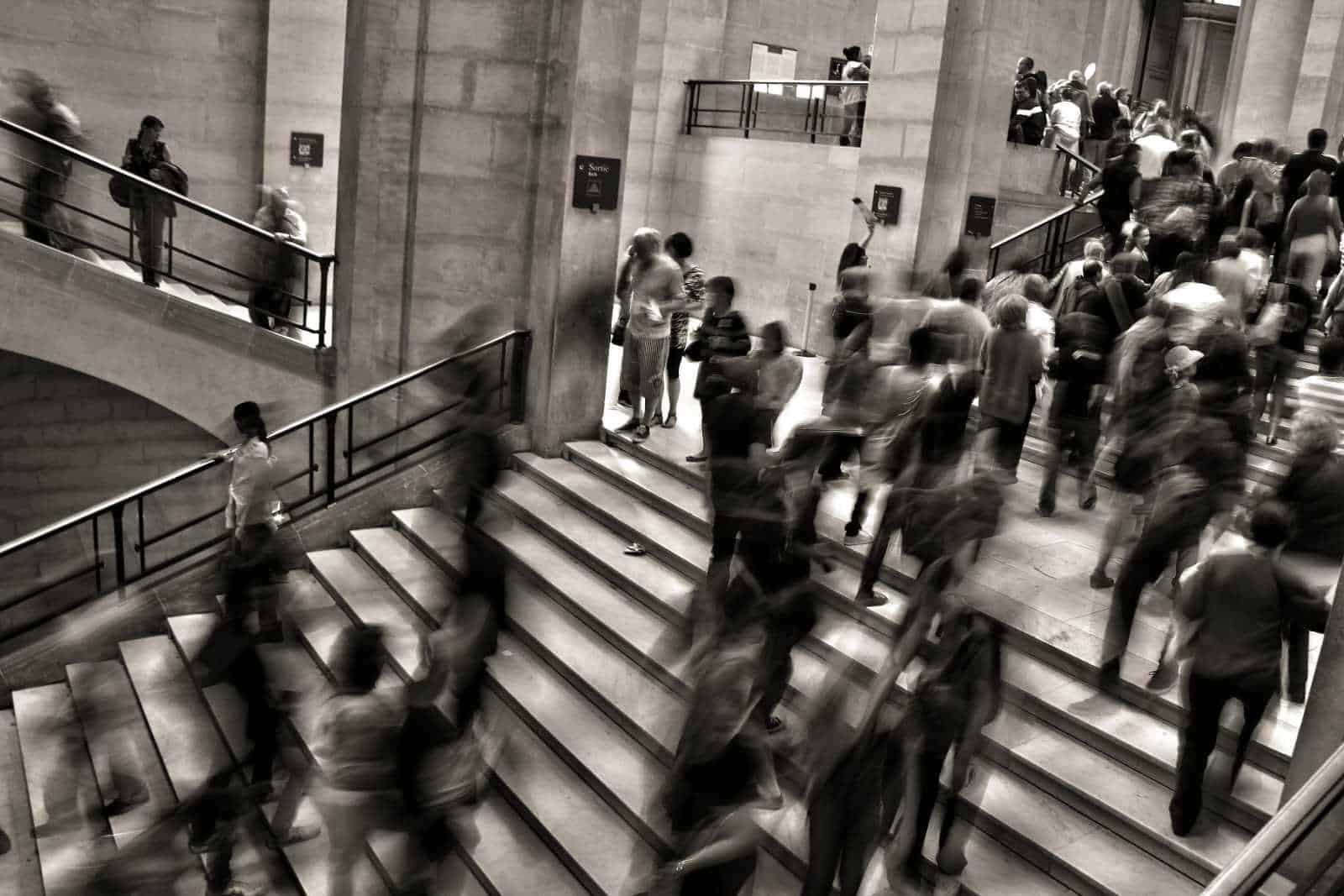 blurred image of workers on stone steps - penguin management services, sydney