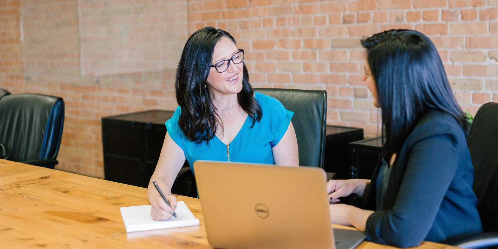 Professionally dressed female being interviewed for a role