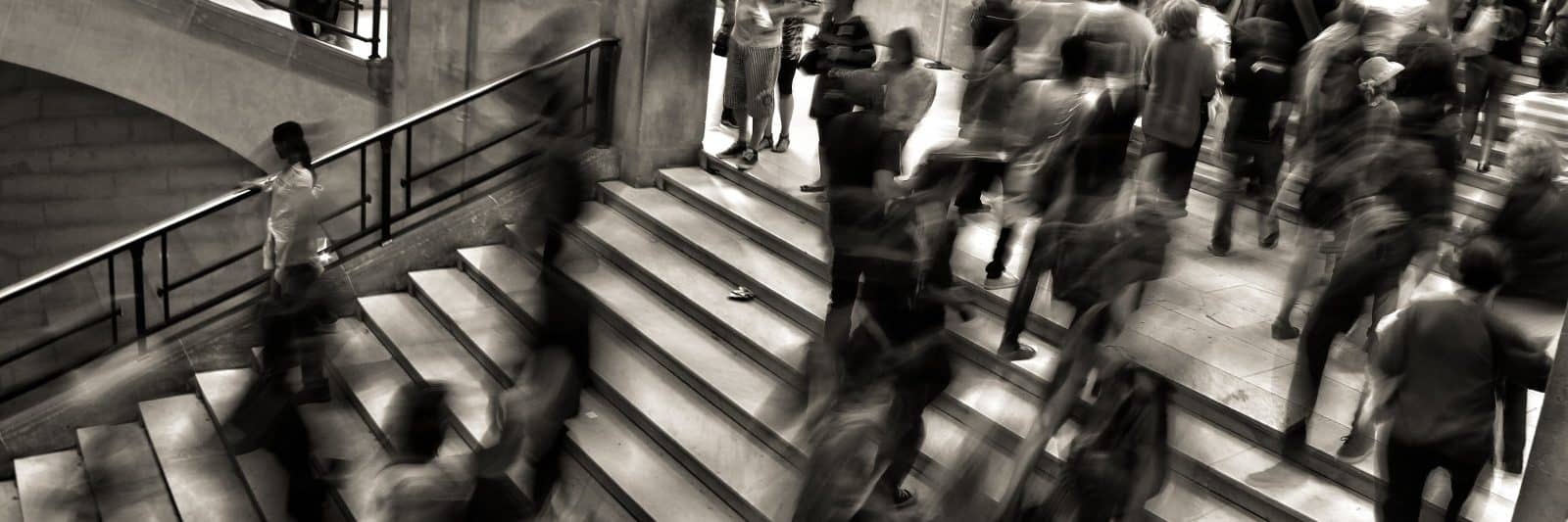 Long exposure of a busy stairwell in black and white