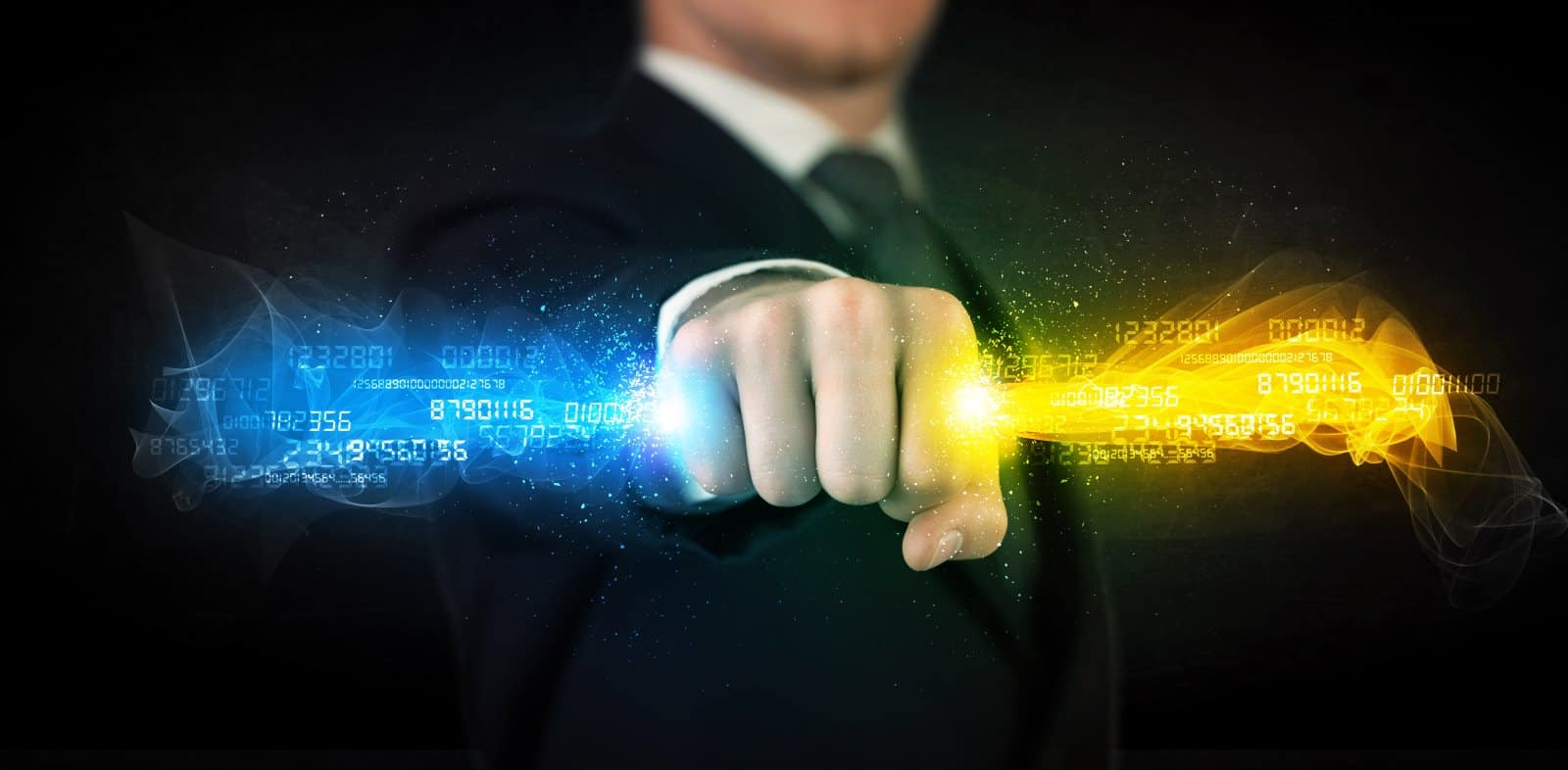 Businessman holding colourful data in his clenched fist