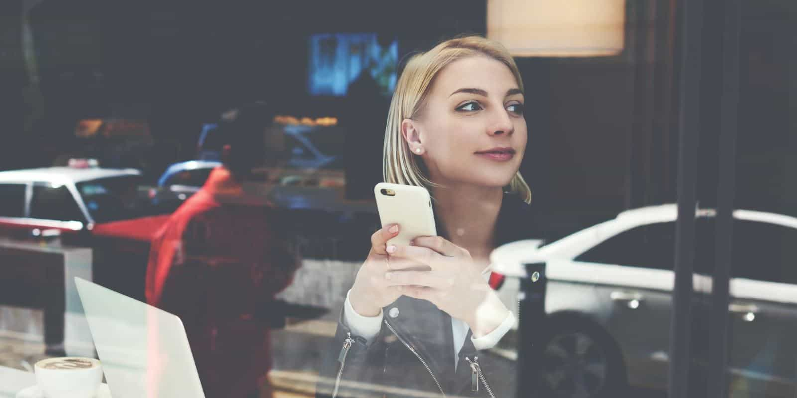 Young woman making an electronic payment on her smartphone
